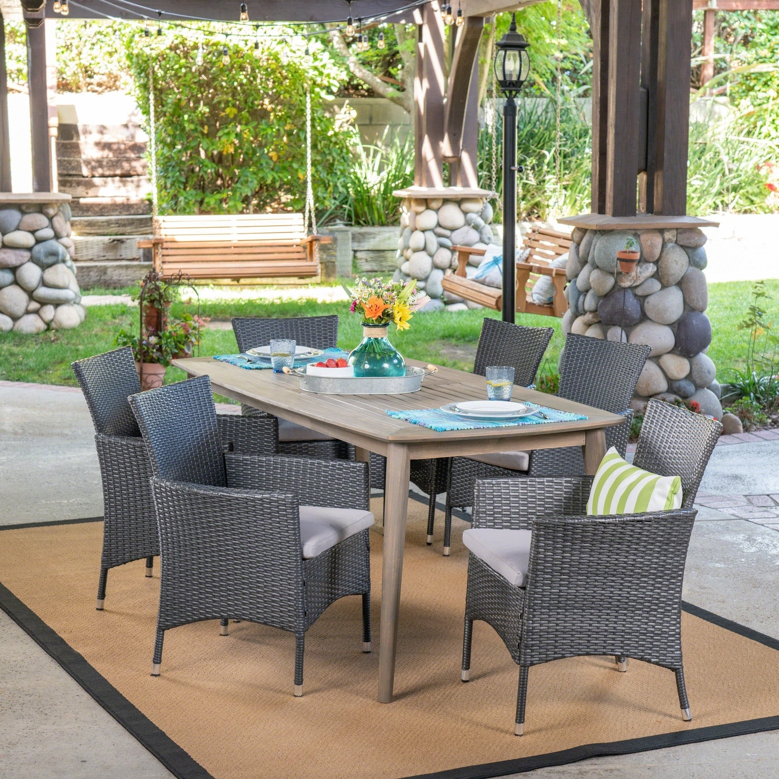 Shop Jaxon Outdoor 7 Piece Multibrown Pe Wicker Dining Set With In Well Known Jaxon Grey 7 Piece Rectangle Extension Dining Sets With Uph Chairs (View 14 of 25)