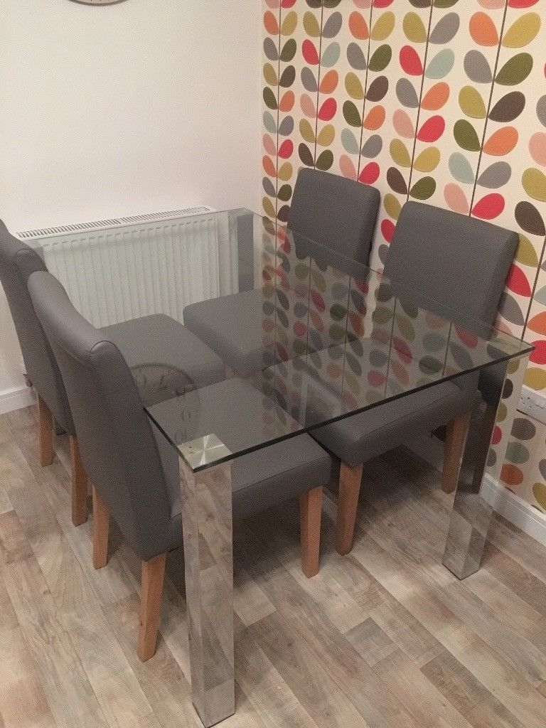 Widely Used Grey Glass Dining Tables Within Next Glass Dining Table And 4 Faux Leather Grey Chairs (View 24 of 25)