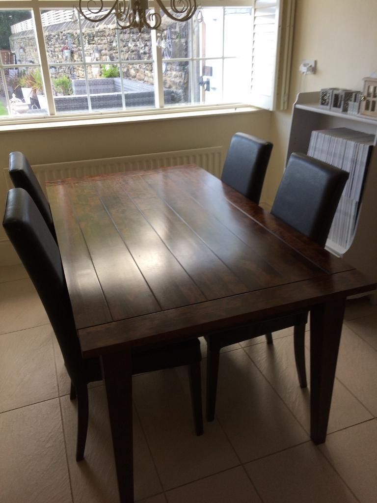 Widely Used Solid Dark Wood Dining Tables Within Solid Dark Wood Dining Tablenext With Matching Chairs (View 12 of 25)