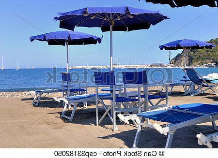 Blue Umbrellas And Sunbeds Within Fashionable Italian Beach Umbrellas (View 12 of 25)