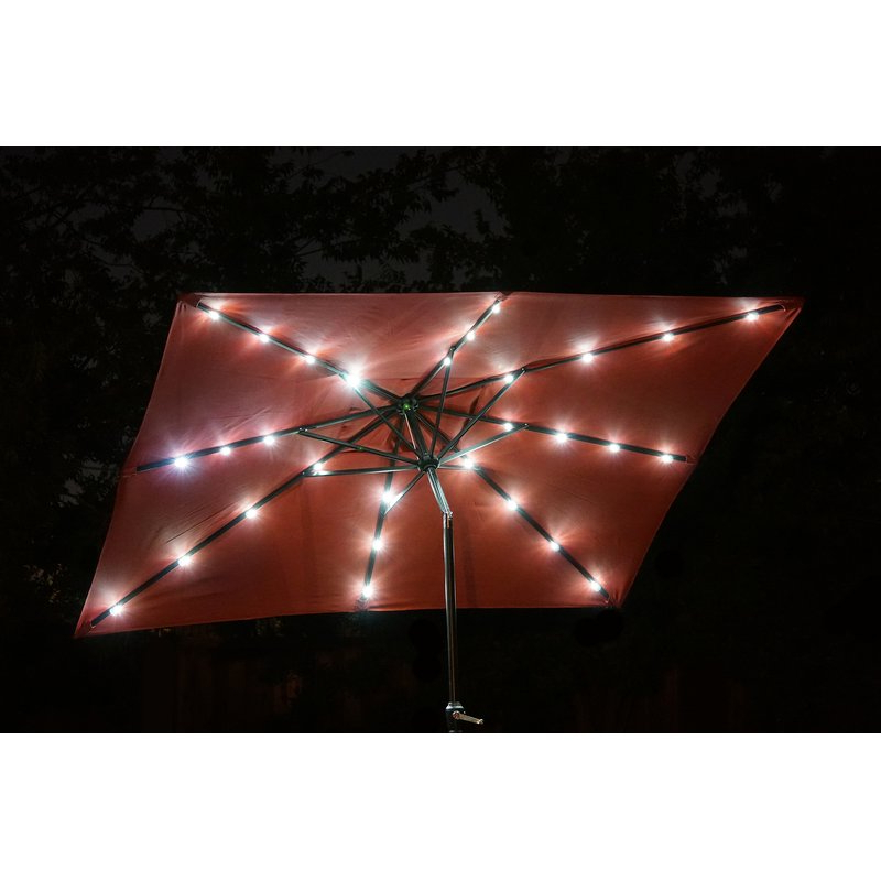 Griselda Solar Lighted  Rectangular Market Umbrellas With Regard To Best And Newest Griselda Solar Lighted 9' X 7' Rectangular Market Umbrella (View 12 of 25)