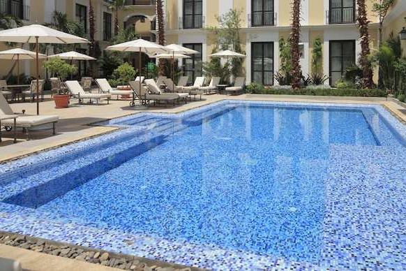 Hotels Regarding Herlinda Solar Lighted Market Umbrellas (Gallery 24 of 25)