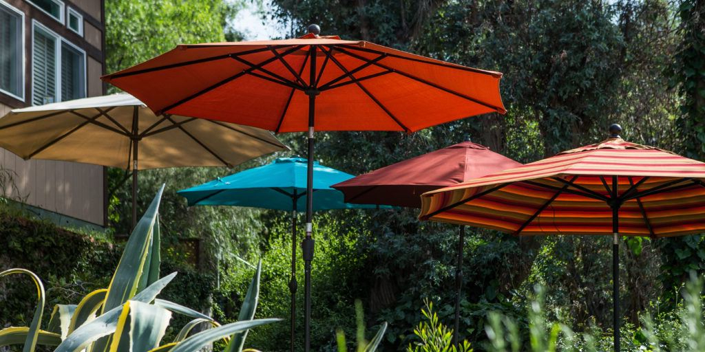 Hurt Market Umbrellas Intended For Preferred The Best Patio Umbrella And Stand: Reviewswirecutter (Gallery 8 of 25)