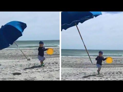 Latest Toddler Nearly Impaledflying Beach Umbrella – Video News Within Julian Beach Umbrellas (View 17 of 25)