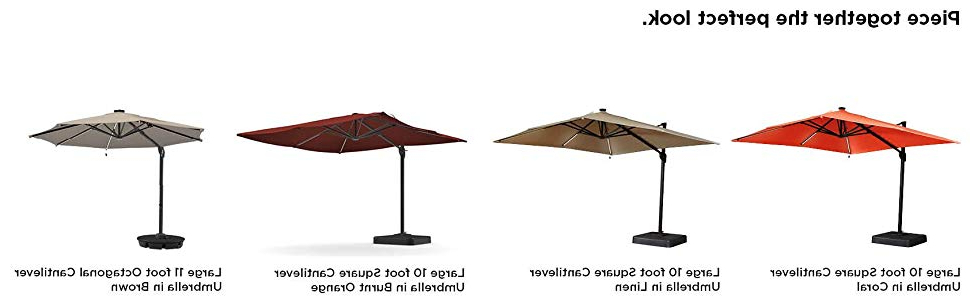 Most Recently Released Cora Square Cantilever Umbrellas Within Ashley Furniture Signature Design – Oakengrove Outdoor Patio Umbrella –  Modern Style – Hand Crank With Vented Canopy – Rectangular – Coral (View 5 of 25)