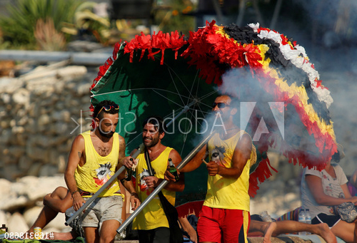 Most Recently Released Revellers Carrying Beach Umbrellas Decorated In The Town's Colours Inside Julian Beach Umbrellas (View 14 of 25)