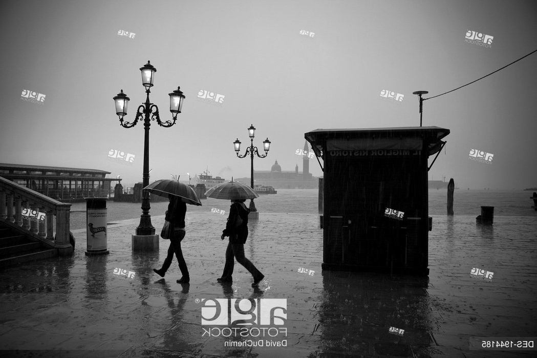 Popular People Walking In The Rain Carrying Umbrellas With Ornate Street Regarding Venice Lighted Umbrellas (View 10 of 25)