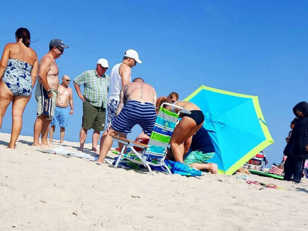 Seaside Beach Umbrellas Inside Popular Tourist Impaledbeach Umbrella Caught In The 'force Of The Wind (View 19 of 25)