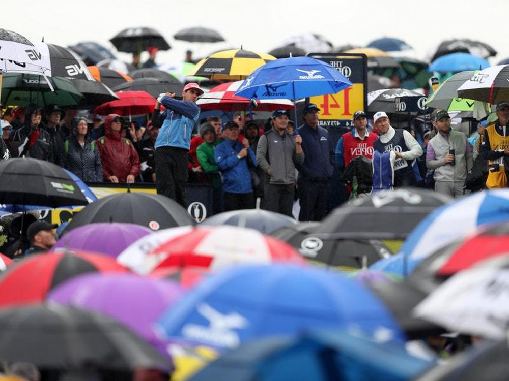 Trendy Sea Of Umbrellas As Golf Fans Brave Rain At Open (View 21 of 25)