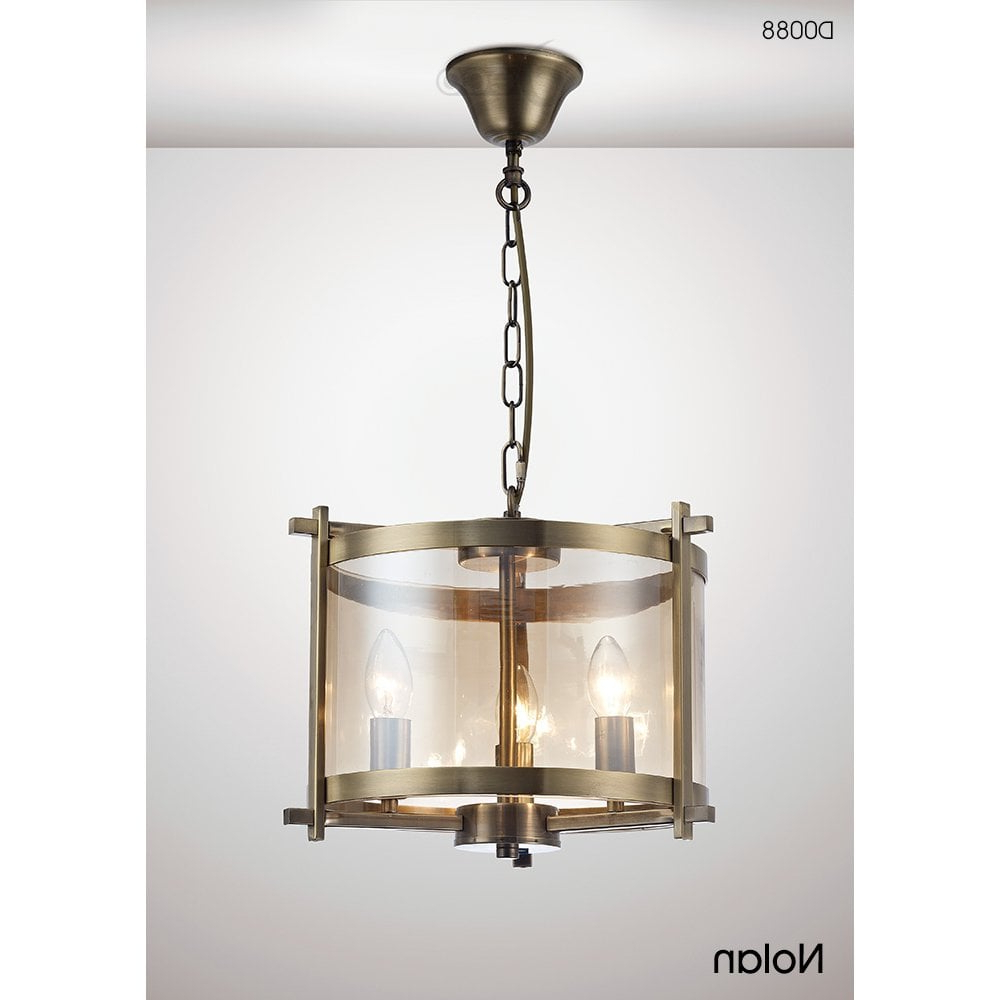Nolan 1 Light Lantern Chandeliers Pertaining To Well Known Nolan Lantern 3 Light Small Ceiling Pendant In Antique Brass Finish With  Clear Glass (View 11 of 25)