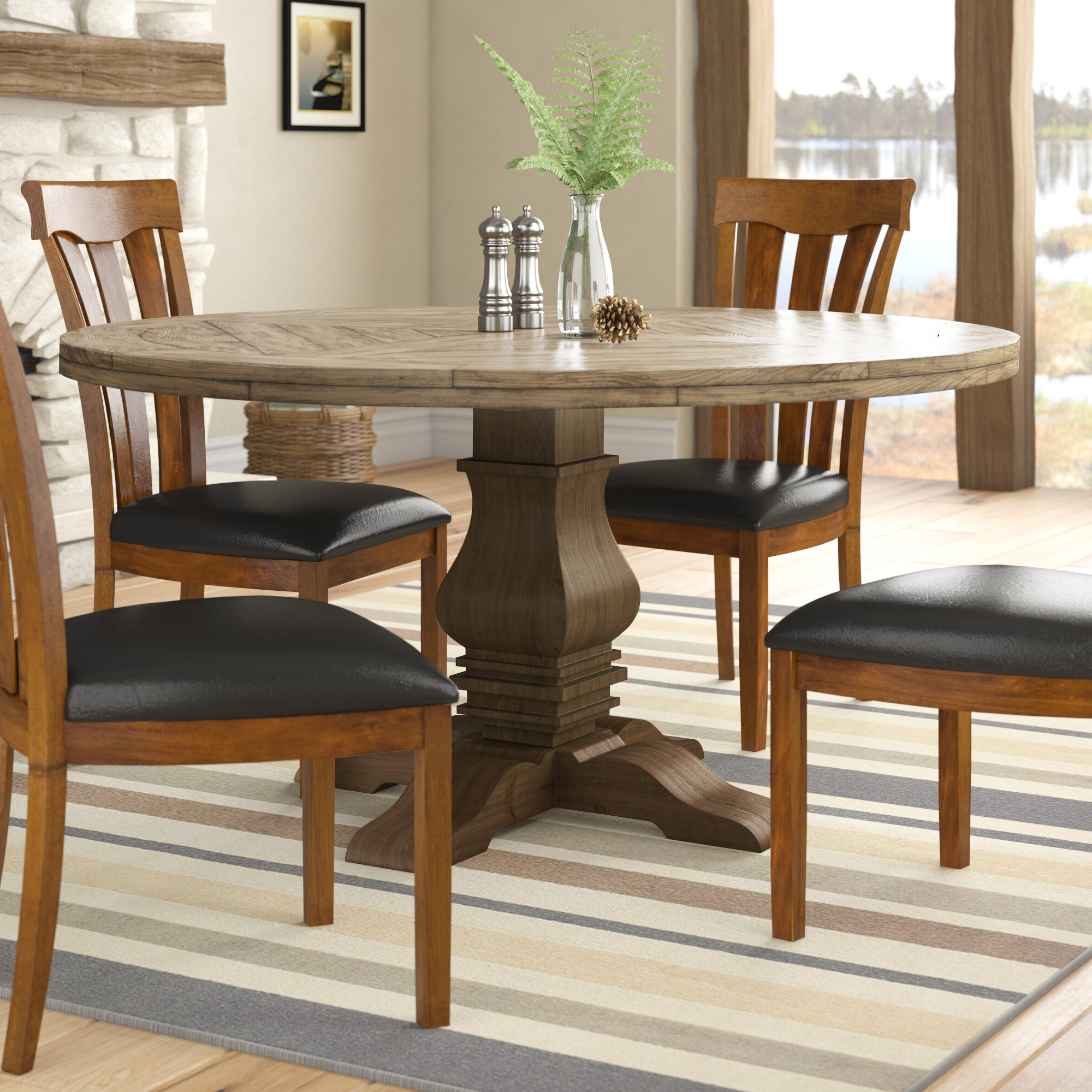Rae Round Pedestal Dining Tables regarding Newest Magaw Solid Wood Dining Table