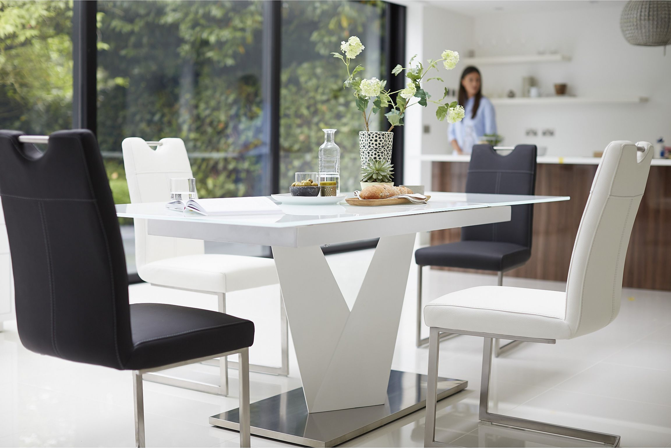 Extending Ultra Modern Dining Table From Habufa Sits Up To 8 Pertaining To Well Known Modern Glass Top Extension Dining Tables In Stainless (View 2 of 25)