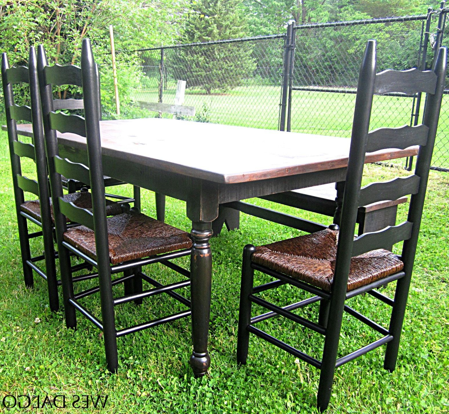 Featured Photo of Distressed Walnut And Black Finish Wood Modern Country Dining Tables