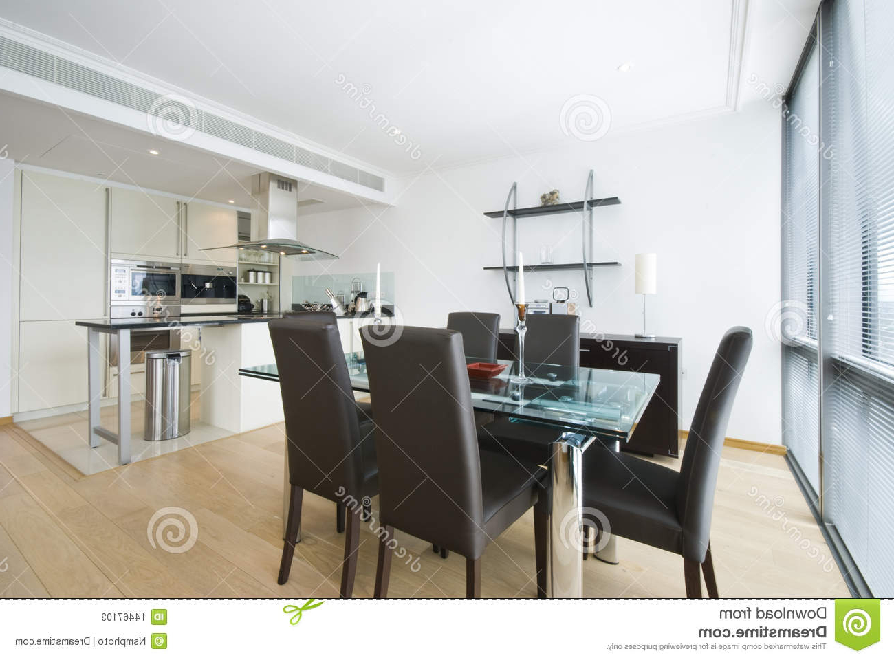 Preferred Contemporary Open Plan Kitchen And Dining Area Stock Image With Regard To Glass Top Condo Dining Tables (View 24 of 25)